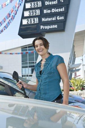 Smiling woman at natural gas station