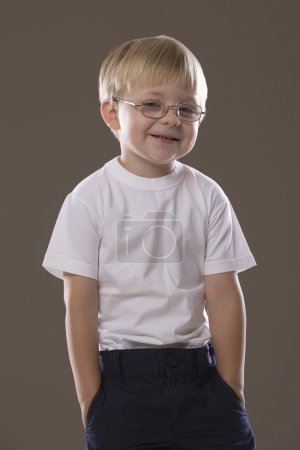 boy wearing glasses smiling