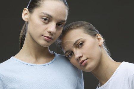 sisters posing in studio