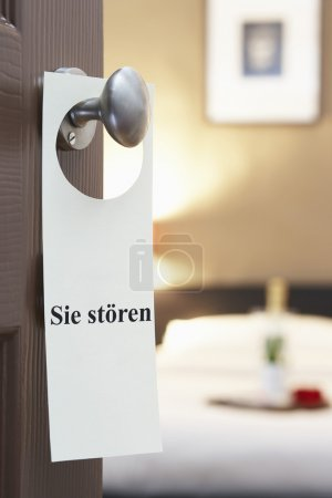 Sign hotel room door