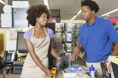 Female store clerk with customer