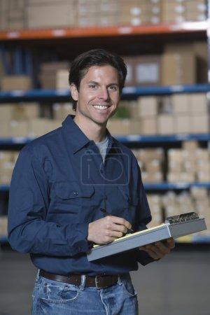 Man in distribution warehouse