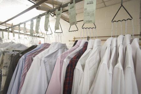 Photo for Close up of clothes hanging in laundrette - Royalty Free Image