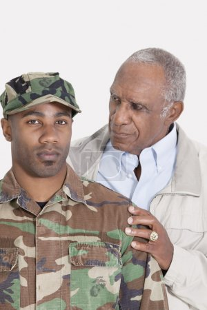 Photo for Portrait of an African American US Marine Corps soldier with father over gray background - Royalty Free Image