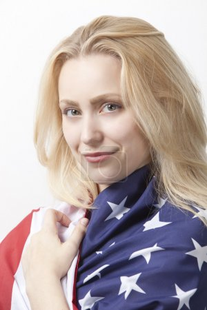 Woman wrapped in American flag