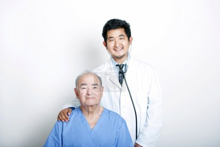 Asian Doctor with  Senior adult patient