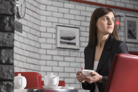 Young woman relaxing in cafe