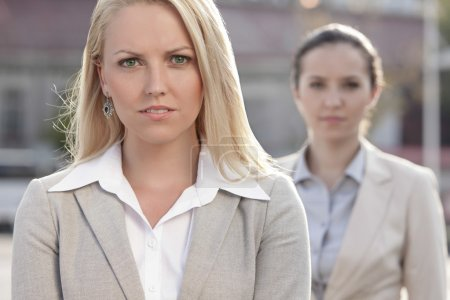 Photo for Portrait of confident young businesswoman with female colleague in background - Royalty Free Image