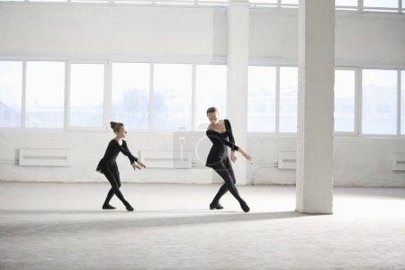 Woman and girl dance