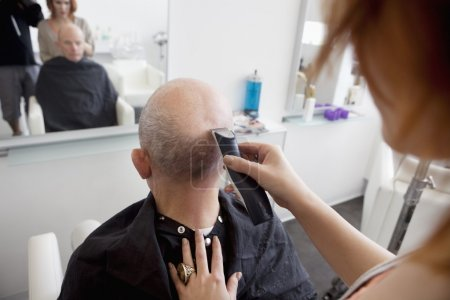 Man getting head shaved