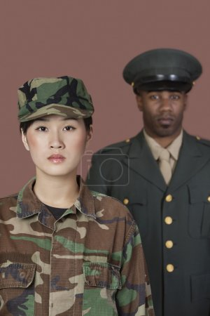 Photo for Portrait of young female US Marine Corps soldier with male officer in background - Royalty Free Image