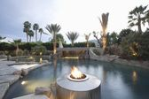 Swimming pool with live flame heater