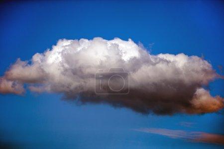 Single cloud against blue sky