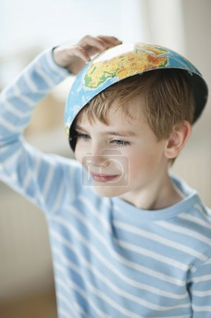 Photo for Little boy with globe half on head - Royalty Free Image