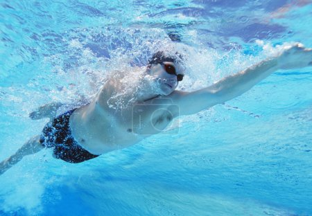 Photo for Underwater shot of professional male athlete swimming in pool - Royalty Free Image