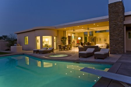 House exterior with sunloungers on patio