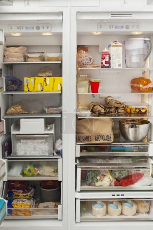 Photo for Close-up of open refrigerator with food items at kitchen - Royalty Free Image