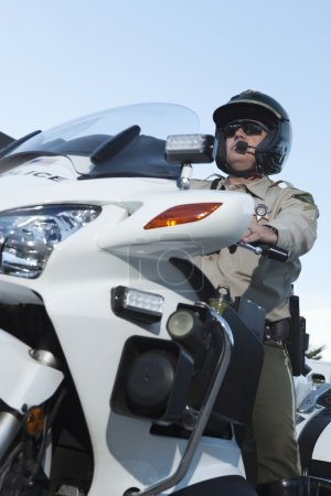 Officer sits on motorcycle