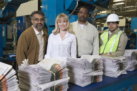 People working in newspaper factory