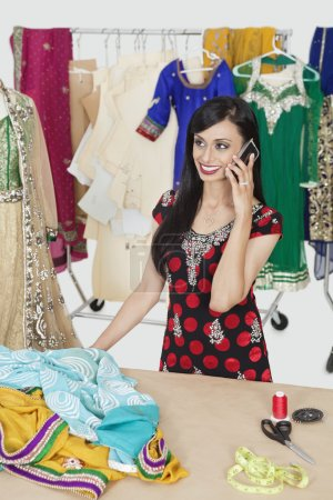 Dressmaker answering phone call