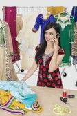 Dressmaker answering phone call