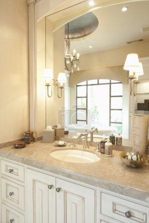 Marble topped cream bathroom