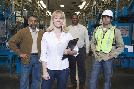 People working in newspaper factory