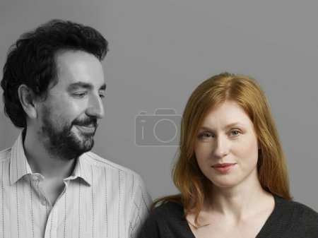 Man looking at woman