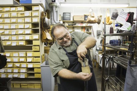 Traditional shoemaker in workshop