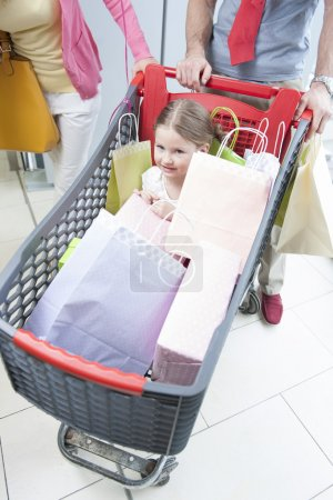 Daughter in trolley being pushed