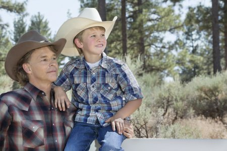 Father and son wearing cowboy hats