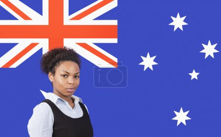 Photo for Young African American businesswoman smiling over Australian flag - Royalty Free Image