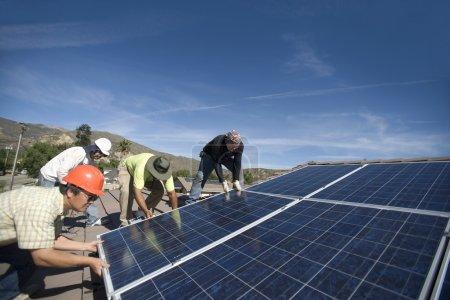 Men laying  large solar panel