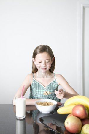 Photo for Teen girl having breakfast - Royalty Free Image