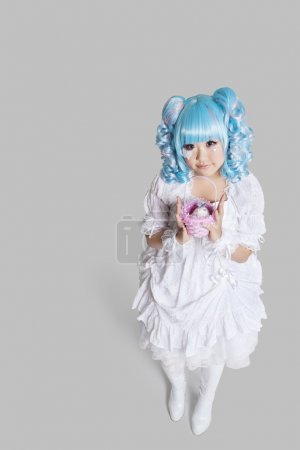 Woman in doll costume holding toy basket
