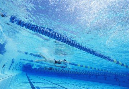 Swimmers racing together