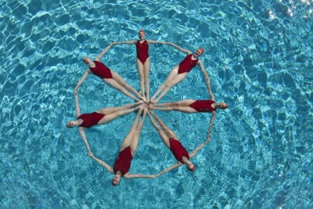 Photo for Group of synchronized swimmers performing - Royalty Free Image