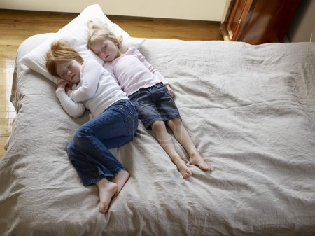 little sisters on bed