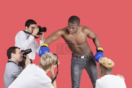 Paparazzi taking photographs of boxer
