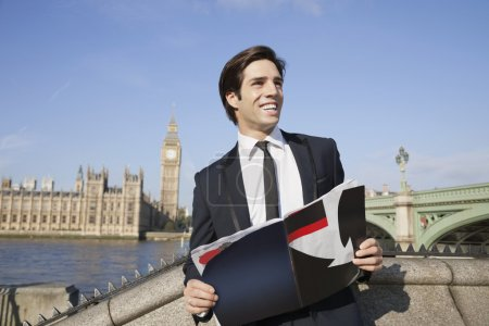 Businessman with book against Big Ben