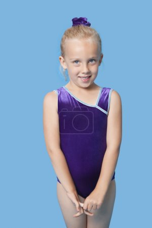 Happy young female gymnast