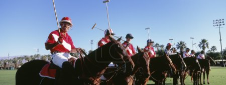 Polo players and umpire