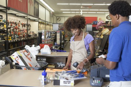 Clerk serving customer