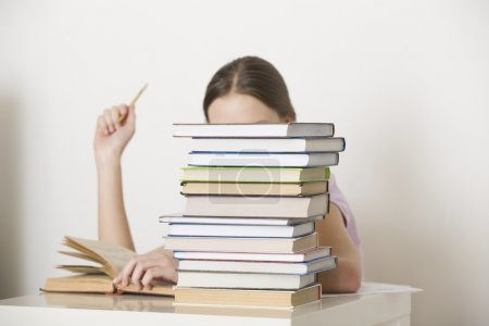 Woman working with books