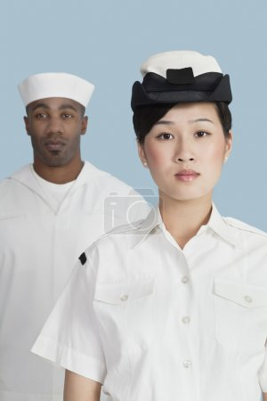 Navy officer in front male sailor
