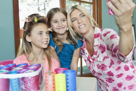 Mother with daughters taking self portrait