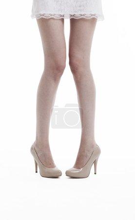 Woman in dress wearing high heels