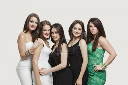 Photo for Portrait of five young women posing together over gray background - Royalty Free Image