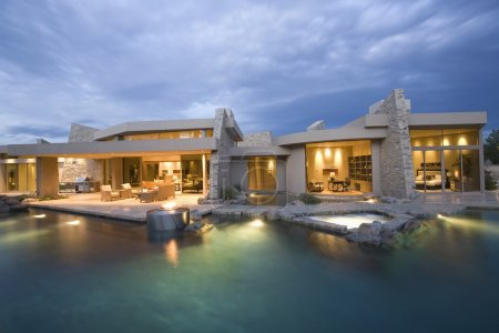 Swimming pool and house exterior at dusk