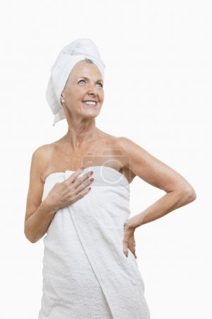 Senior woman wrapped in towels